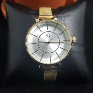 CHARMING CHARLIE GOLD TONE WATCH
